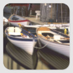Fog surrounds four boats docked. stickers