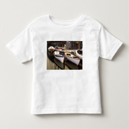 Fog surrounds four boats docked. toddler t-shirt