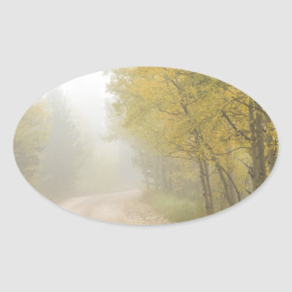 Foggy Dirt Road In The Autumn Season Oval Sticker