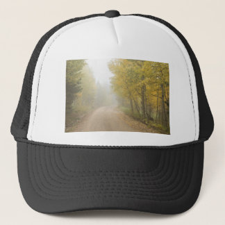 Foggy Dirt Road In The Autumn Season Trucker Hat