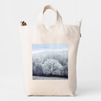 Foggy Winter Landscape with snow covered Trees Duck Bag