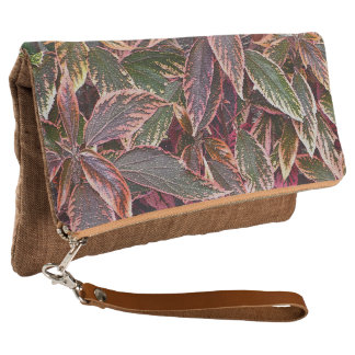 FOLD-OVER CLUTCH /LEAVES /SOFT MUTED COLORS