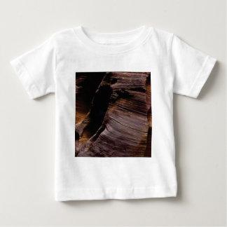 folds of the dark brown rock baby T-Shirt