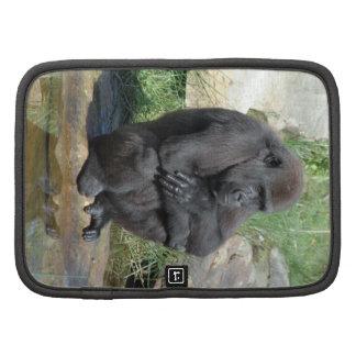 Folio de la cartera del gorila que se sienta planificadores