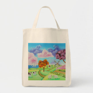 Folk art landscape with a windmill painting tote bag