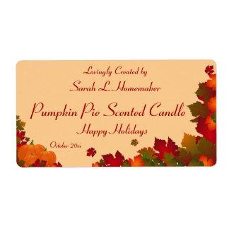 Follaje de otoño con la vela o el enlatado de las  etiquetas de envío