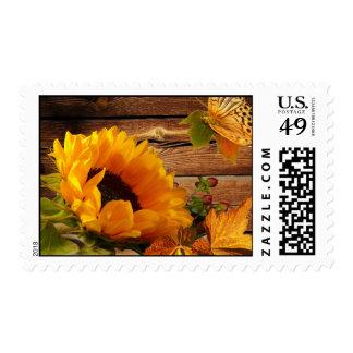 Follaje rústico de la mariposa del girasol de la timbre postal