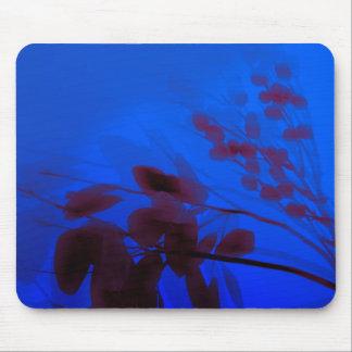 Follaje sobre azul alfombrilla de ratón