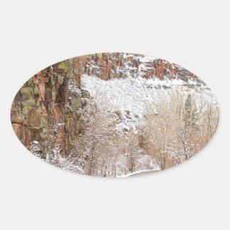 Follow The Red Rock Ridge Winter Road Oval Sticker