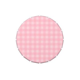 Fondo a cuadros del modelo de la guinga rosada frascos de caramelos