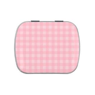 Fondo a cuadros del modelo de la guinga rosada latas de caramelos