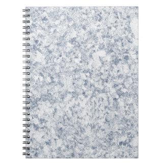 fondo abigarrado púrpura azul libro de apuntes con espiral
