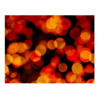 Fondo abstracto con las luces borrosas postal