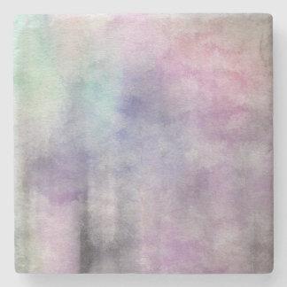 fondo abstracto de la acuarela del arte en el posavasos de piedra