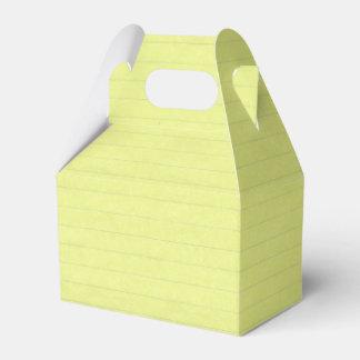 Fondo alineado amarillo del papel de escuela cajas para regalos de fiestas