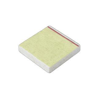 Fondo alineado amarillo del papel de escuela imán de piedra