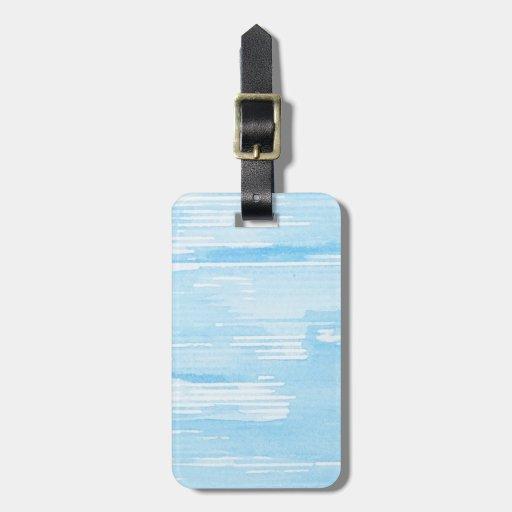 Fondo azul abstracto de la acuarela, textura etiqueta de maleta