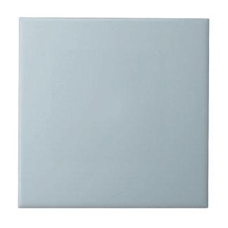 Fondo azul claro silenciado del color sólido del a azulejo cuadrado pequeño