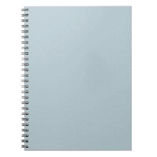 Fondo azul claro silenciado del color sólido del a libro de apuntes