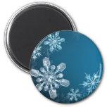 Fondo azul del copo de nieve del navidad imán