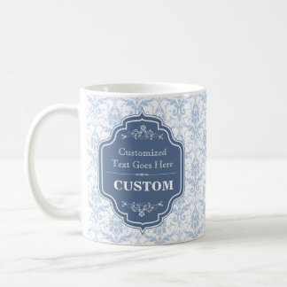 Fondo azul del damasco de la etiqueta del vintage taza