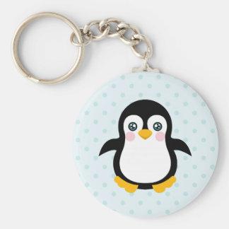 Fondo azul del lunar del diseño lindo del pingüino llavero