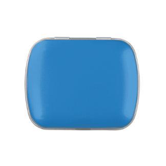 Fondo azul medio del color del día de fiesta de Já Latas De Dulces