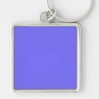 Fondo azul púrpura de la tendencia del color del llavero cuadrado plateado