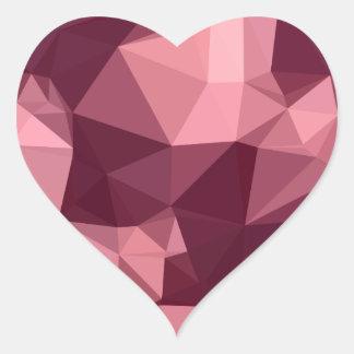Fondo bajo abstracto púrpura imperial del polígono pegatina en forma de corazón