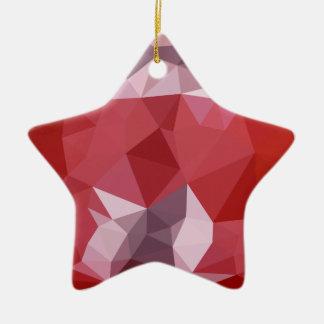 Fondo bajo abstracto rojo del polígono de la adorno navideño de cerámica en forma de estrella