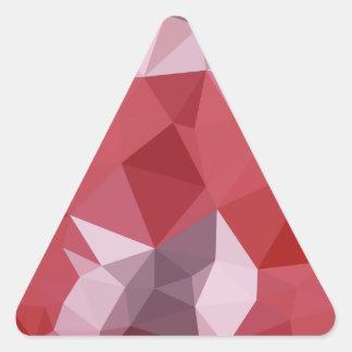 Fondo bajo abstracto rojo del polígono de la pegatina triangular