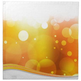 Fondo borroso de la luz anaranjada servilletas