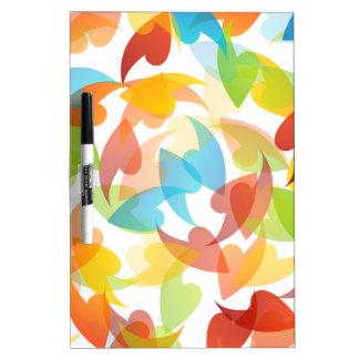 fondo coloreado arco iris con las hojas pizarras blancas de calidad