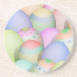 Fondo coloreado de los huevos de Pascua Posavasos Diseño