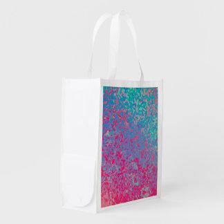 Fondo corroído colorido reutilizable del bolso de bolsas de la compra