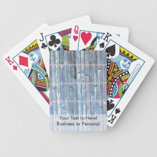 fondo de bambú del azul de la estera baraja cartas de poker