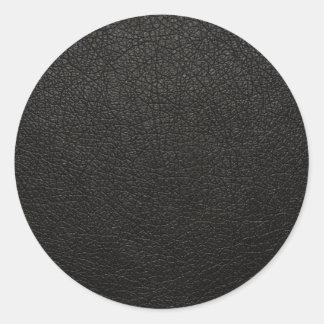 Fondo de cuero negro de la textura etiquetas redondas