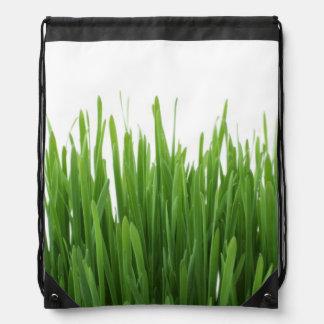 Fondo de la hierba verde mochilas