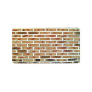 Fondo de la pared de ladrillo con los ladrillos mu etiqueta de dirección