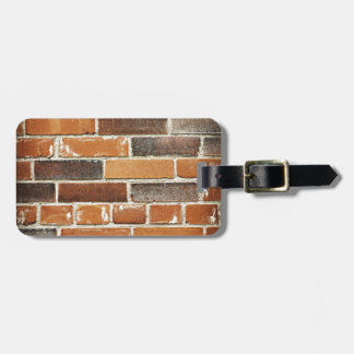 Fondo de la pared de ladrillo etiqueta para maleta