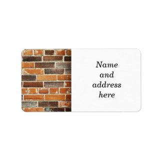 Fondo de la pared de ladrillo etiquetas de dirección