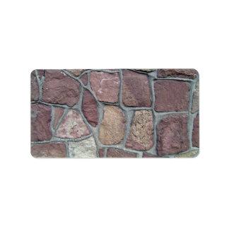Fondo de la pared de piedra de piedras naturales etiqueta de dirección