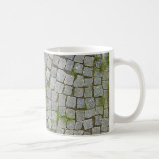 Fondo de la textura del camino del guijarro taza clásica