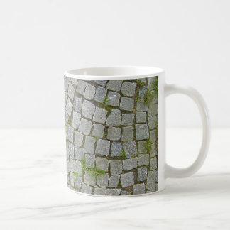 Fondo de la textura del camino del guijarro taza de café