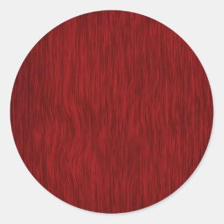 Fondo de madera áspero del grano - rojo pegatina redonda