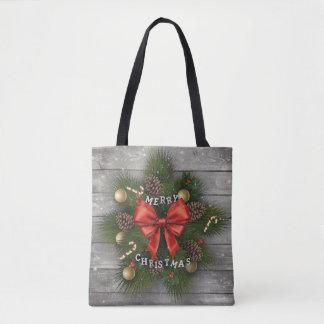 Fondo de madera con los ornamentos del navidad bolsa de tela