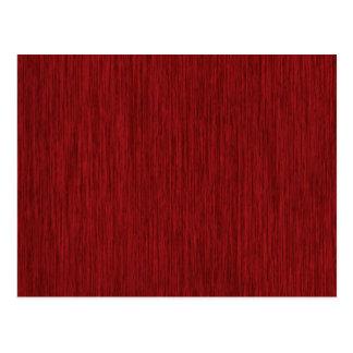 Fondo de madera granoso rojo postal