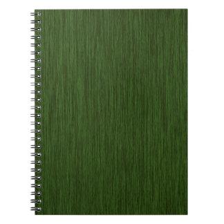 Fondo de madera granoso rústico verde libros de apuntes