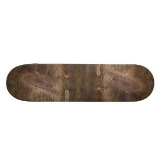 Fondo de madera nudoso rústico oscuro lindo de la  monopatin