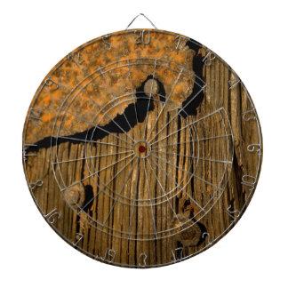 Fondo de madera oxidado tablero dardos